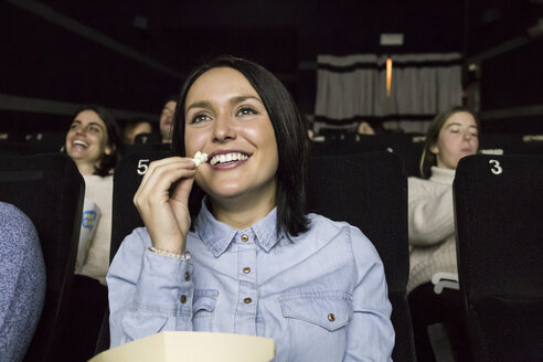 Woman watching a movie in a cinema - ABZF01627