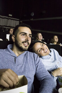 Couple watching a movie in a cinema - ABZF01630