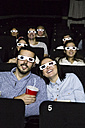 Couple with 3d glasses watching a movie in a cinema - ABZF01633