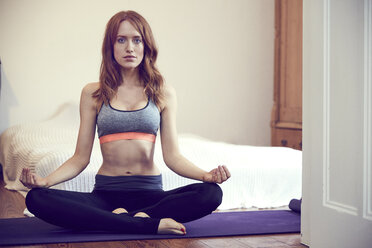 Redheaded woman doing yoga exercise at home - SRYF00173