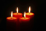 Four lighted red candles - JTF00791
