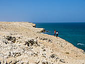 Oman, Ash Sharqiyah, Ad Daffah, two women standing at cliff coast - AMF05148