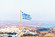 Greece, Milos, Greek flag over Plaka - GEMF01310