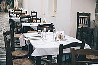 Greece, Milos, Plaka, Empty street restaurant - GEMF01313