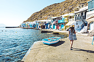 Greece, Milos, Woman walking in the colorful fishermen's village Klima - GEMF01340