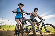 Young couple mountain biking in nature - ZEF11870