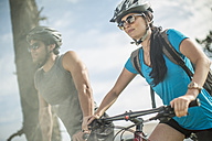 Young couple mountain biking in nature - ZEF11879
