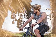 Young man mountain biking in nature - ZEF11882