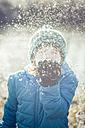 Boy blowing snow - SARF03096