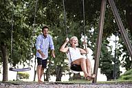 Happy senior couple on playground - HAPF01249