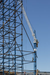 Construction crane and scaffold on construction site - ZEF11961