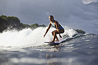 Indonesia, Bali, woman surfing - KNTF00591