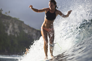 Indonesia, Bali, woman surfing - KNTF00597