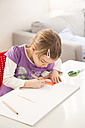 Little girl making a drawing on sheet of paper - LVF05734