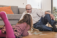 Grandfather and granddaughter playing memory - UUF09568