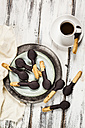 Spoon-shaped biscuits with chocolate icing on plate and a cup of espresso - SBDF03101