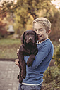 Boy holding Labrador Retriever - MFF03393