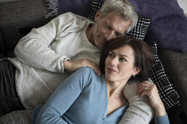 Mature couple relaxing on couch - RBF05348
