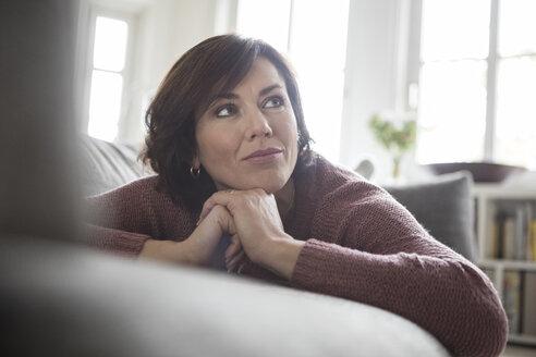 Woman at home lying on the sofa - RBF05402