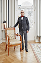 Senior man wearing bow tie at home - RHF01710