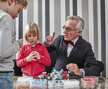 Grandfather and grandchildren with molecular model - RHF01734