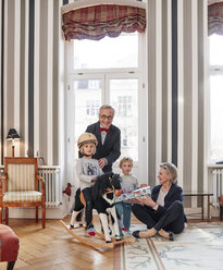 Grandparents and grandchildren with rocking horse and gift - RHF01746