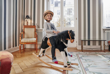 Happy girl posing on rocking horse - RHF01752