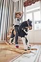 Happy girl posing on rocking horse - RHF01755