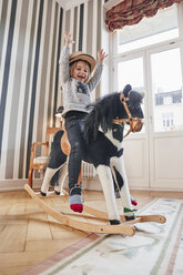 Happy girl posing on rocking horse - RHF01755