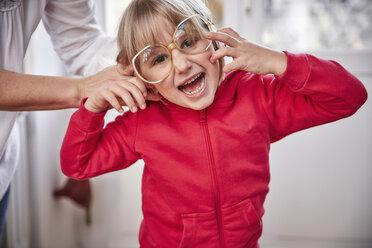 Portrait of playful girl wearing oversized glasses - RHF01770