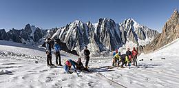 France, Chamonix, Argentiere Glacier, les Droites, Les Courtes, Aiguille Verte, group of mountaineers preparing - ALRF00761