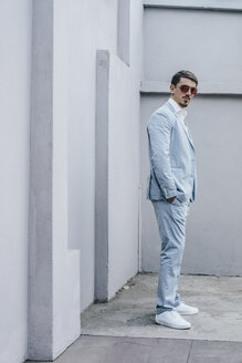 Portrait of confident businessman wearing sunglasses - KNSF00825