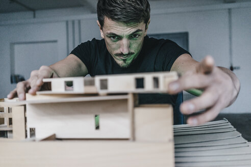 Architect working on architectural model - KNSF00831