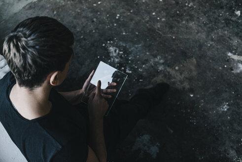Man using transparent mobile device - KNSF00837