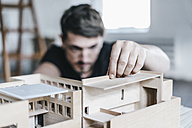 Architect working on architectural model - KNSF00861