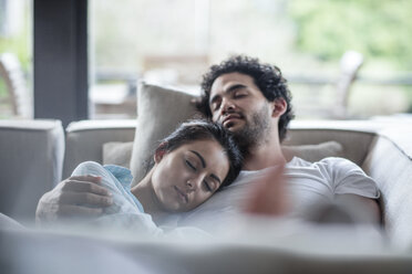 Young couple sleeping on a couch - ZEF12024
