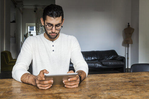 Young man using digital tablet in modern office - TCF05279