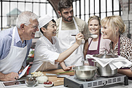Group of people taking cooking course - ZEF12094