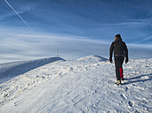Italy, Umbria, Apennines, man hiking to the summit of Mount Catria - LOMF00467