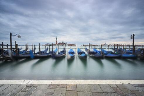 Italy, Venice, moored gondolas at twilight - XCF00108