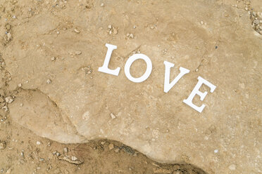 White letters building the wotd 'Love' on a rock - KKAF00280