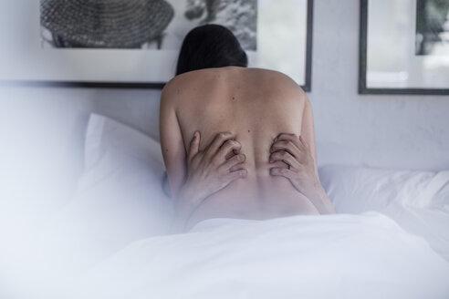 Couple having sex in bed - ZEF12199