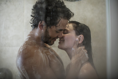 Intimate young couple in shower - ZEF12223