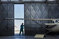 Mechanic opening hangar gate - ZEF12229