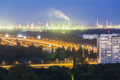 Slovakia, Bratislava, view to oil refinery and urban motorway at night - WDF03841