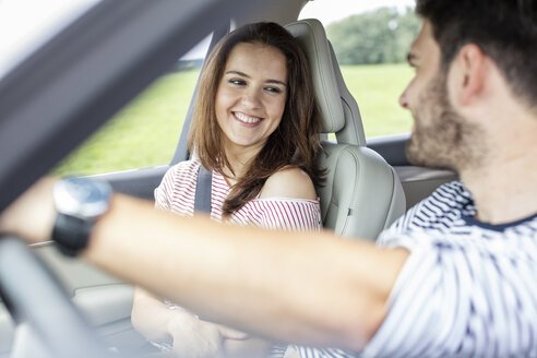 Couple driving in car - WESTF22338