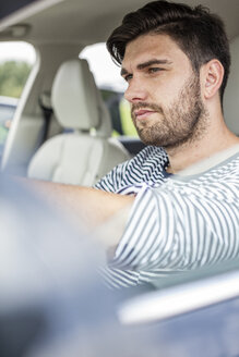 Mid adult man driving in car - WESTF22401