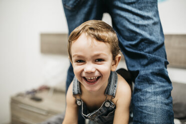 Portrait of laughing little boy at home - JRFF01125