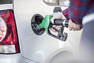 Woman fueling car - ZEF12293