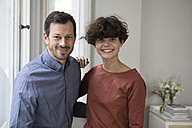 Portrait of happy couple at home - RBF05424